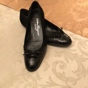 Black loafers/flats by Ferragamo